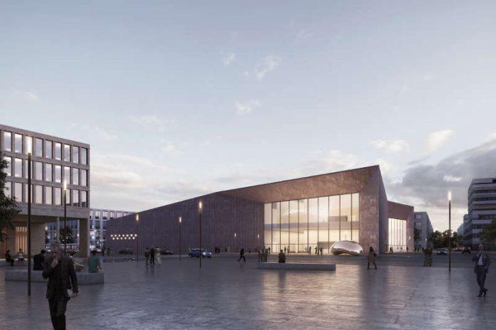 Das Büro DEGELO Architekten aus Basel sieht für das Konferenzzentrum in der Bahnstadt ein architektonisch markantes Gebäude mit einer rötlich gefärbten Fassade vor. Vom Bahnhofsplatz Süd aus bietet sich ein freier Blick auf den Bereich des Haupteingangs. (Foto: DEGELO Architekten)