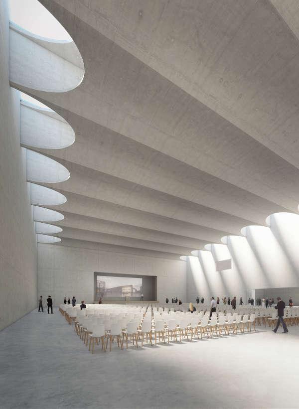 Blick in den Großen Saal des Konferenzzentrums im Siegerentwurf von DEGELO Architekten aus Basel mit der leicht zur Bühne hin abfallenden Decke. (Foto: DEGELO Architekten)