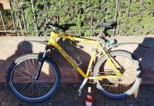 Radfahrer - Hand an Weinflasche, statt am Lenker